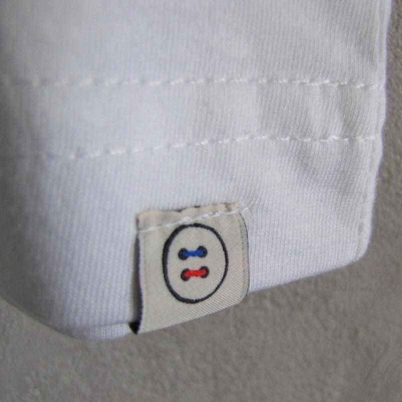 logo gentle factory cousu en bas du tshirt